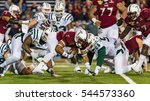 Small photo of Mobile, Alabama - 12/23/2016: Troy University #26 B.J. Smith recovers his own fumble after a kick-off from the Ohio Bobcats during the Dollar General Bowl at Ladd-Peebles Stadium.