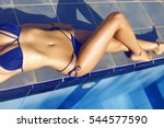 elegant lady relaxing over pool ... | Shutterstock . vector #544577590