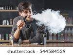 vape. vaping man in a cloud of...   Shutterstock . vector #544584529
