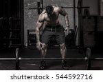 muscular man in about to pickup ... | Shutterstock . vector #544592716
