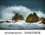 Waves Crashing Onto The Rocks...