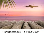 airplane flying over tropical... | Shutterstock . vector #544659124