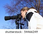 Close up of attractive female photographer - stock photo