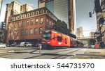 Stock photo red trolley through the building from sidewalk street in downtown san diego city usa 544731970