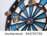 Dartboard With Three Darts  On...