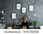 room area with woman working at ... | Shutterstock . vector #544750558