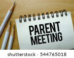 Small photo of Parent Meeting text written on a notebook with pencils