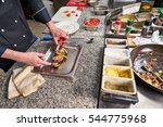 chef in restaurant garnishing... | Shutterstock . vector #544775968