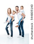 smiling parents piggybacking... | Shutterstock . vector #544805140