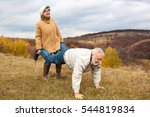 Elderly Couple Having Fun And...