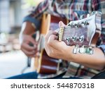 Young Hipster Man Playing...