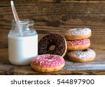 Various Donuts With Milk Bottle
