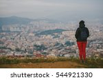 BARCELONA, SPAIN - DECEMBER 25, 2015: People watching panorama of Barcelona - stock photo