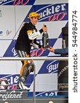 Small photo of JEREZ DE LA FRONTERA, SPAIN-NOV 20: 125cc motorcyclist Alex Rins on the podium like winner of the 125cc CEV Championship celebrating with champagne on November 20, 2011, in Jerez de la Frontera, Spain