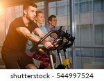sports people on stationary bike   Shutterstock . vector #544997524