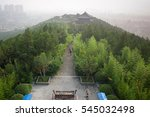 Wooded Hilltop Above Polluted...