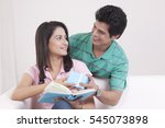 man giving a gift to his woman... | Shutterstock . vector #545073898