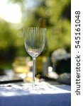 Small photo of Alfresco dining, table set for an evening meal outside