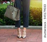 women's legs in grey high heels ... | Shutterstock . vector #545179033