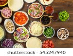 preparing individual pizzas...   Shutterstock . vector #545247940