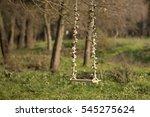wooden swing with flowers in... | Shutterstock . vector #545275624