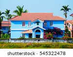 Small photo of Bright colors. Blue house near the beach in Benaulim, South Goa, India. On the sunny day colors are more brighter.