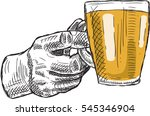 the glass of alcohol in hand.... | Shutterstock .eps vector #545346904