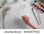 Woman Drawing Flower On Album...