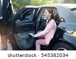 Small photo of Businesswoman in luxury car