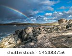 Small photo of Amazing natural landscape with rainbow and rocks at scotland
