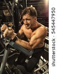 Small photo of Abs workout. Cropped portrait of a strong muscular shirtless sportsman working on his abs exercising on ab coaster machine at the gym dedication strength fitness lifestyle concept
