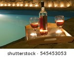 2 glasses and bottle of wine at ... | Shutterstock . vector #545453053