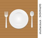 empty plate on wood table  | Shutterstock .eps vector #545494690