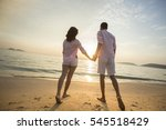 couple hand by hand at sunset.... | Shutterstock . vector #545518429