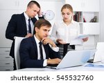 Small photo of three worried coworkers different sexes experiencing business failure in firm office