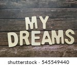 dream wooden letters on wooden... | Shutterstock . vector #545549440