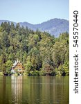Color Image Of A Cabin In The...