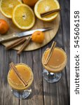 Small photo of alcoholic beverage with orange juice and cinnamon