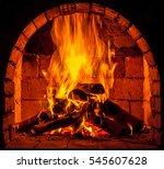 a fire burns in a fireplace. | Shutterstock . vector #545607628