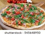 pizza with prosciutto   arugula ... | Shutterstock . vector #545648950