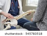 doctor showing patient what is... | Shutterstock . vector #545783518