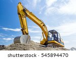 Yellow Excavator Is Making Pile ...