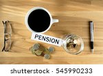 pension word on desk with coins ... | Shutterstock . vector #545990233