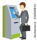 Businessman Using Atm Machine....
