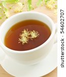 white cup with lime tea and... | Shutterstock . vector #54602707
