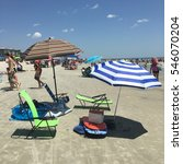 Small photo of 10 August 2016 Coligny beach on Hilton head island USA what you need a big umbrella, beach chair, cooler, boogie board, floater ring and seating mat then you are set for a relaxing day