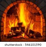 a fire burns in a fireplace. | Shutterstock . vector #546101590