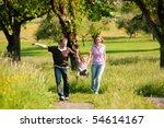 family having a walk outdoors...   Shutterstock . vector #54614167