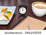 alarm clock on table wooden | Shutterstock . vector #546145039