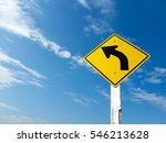 Small photo of Warning traffic signs ahead of the curve with blue sky